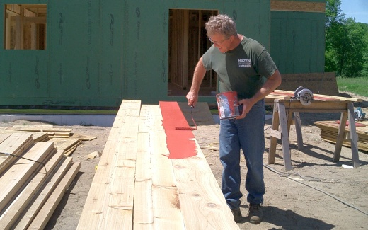 Michael painting backs of fascia boards
