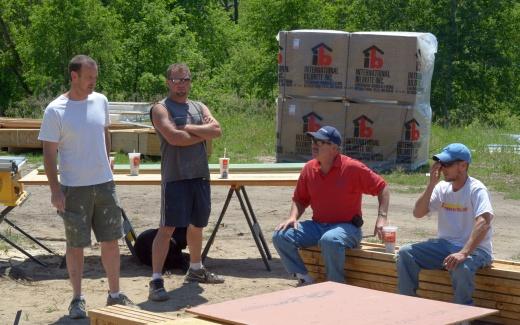 Andy, Bill, Fred, Matt in front of materials