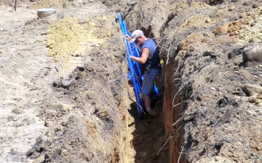 Randy LaLone placing water line