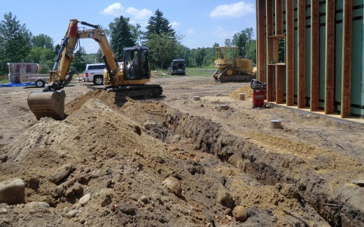 Excavating water line trench