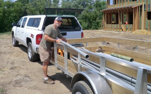 Bryan Bach preparing conduit for electrical service