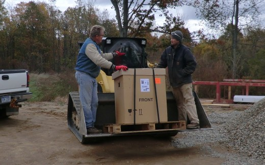 Michael and Bruce transporting energy recovery unit