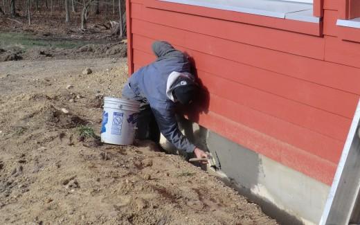 Applying concrete to exterior foundation