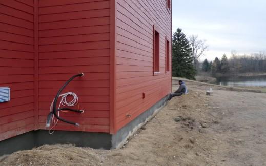 Foundation concrete; mini-split compressor lines visible