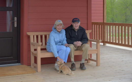 Nancy and Jerry Frost on bench Jerry made and gave to us